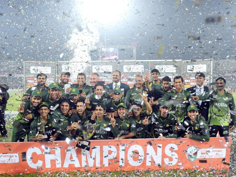 Pakistan cricketers pose for a photo with the tournament trophy following the one day international Asia Cup cricket final match against Bangladesh at The Sher-e-Bangla National Cricket Stadium in Dhaka. AFP/Munir uz Zaman