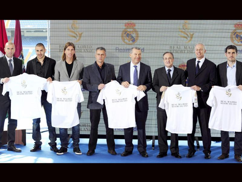 (From L) Former football player Zinedine Zidane, Real Madrid's Karim Benzema, Sergio Ramos, coach Jose Mourinho, representative of the government of the United Arab Emirates Ras Al Khaimah, Khater Massaad, Real Madrid president Florentino Perez, Louis Armand de Rouge, CEO of RAK Investments and Real Madrid's Iker Casillas pose during the presentation of the Real Madrid Sport Resort at Santiago Bernabeu stadium in Madrid. AFP Photo/Javier Soriano