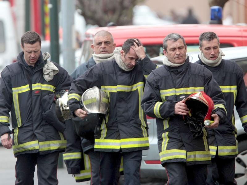 French firefighters leave after a police assault on a suspected Islamic extremist holed up in an apartment in Toulouse, southwestern France. AP Photo/Bob Edme
