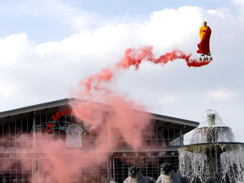 Suspended by wires, Chinese artist Li Wei performs in the sky over the Fontaine of Lyons at La Villette in Paris. (AP Photo/Francois Mori)