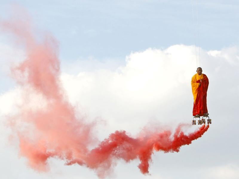 Chinese artist Li Wei performs in the sky at La Villette in Paris . Li Wei born is a contemporary artist from Beijing, China. His work often depicts him in apparently gravity-defying situations. (AP Photo/Francois Mori)