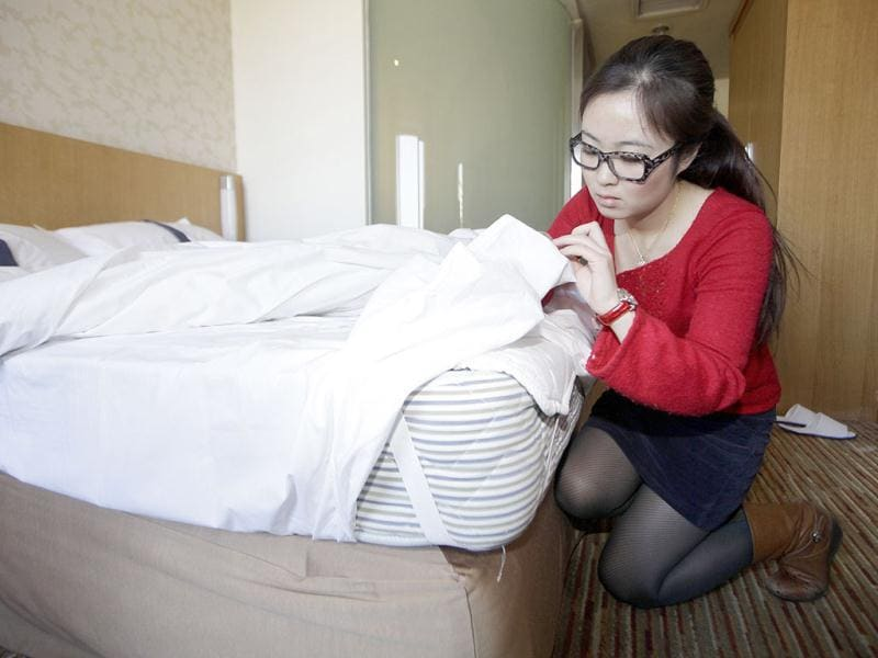 Zhuang, a Hotel Test Sleeper, checks the bed of a business chain hotel in Beijing. Qunar, a Chinese online travel platform, started to recruit Professional Hotel Test Sleepers. The requirement for this new profession is to sleep at selected hotels without disclosing their real job and write expert reviews about the facilities, location, dining, services and prices of the hotels, in order to provide an independent third-party evaluation and an authoritative guide to travelers, according to the company. (Reuters)