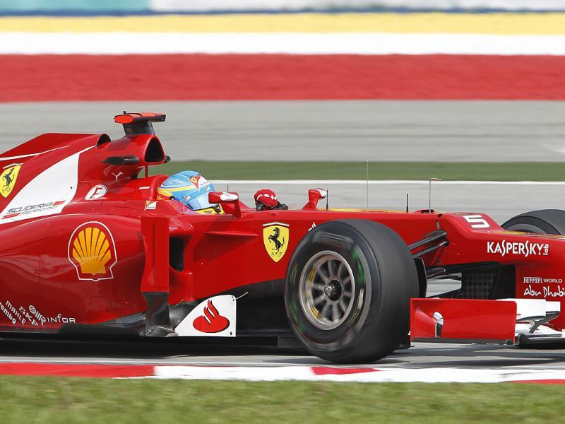 Ferrari Formula One driver Fernando Alonso of Spain steers his car during the first practice session at the Malaysian Formula One Grand Prix at Sepang, Malaysia. (AP Photo/Lai Seng Sin)
