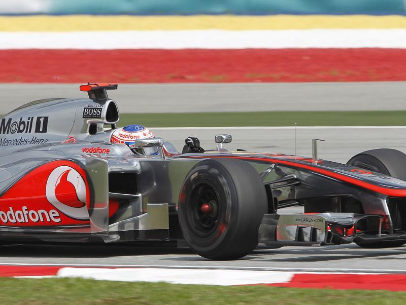 McLaren Formula One driver Jenson Button of Britain steers his car during the first practice session at the Malaysian Formula One Grand Prix at Sepang, Malaysia. (AP Photo/Lai Seng Sin)