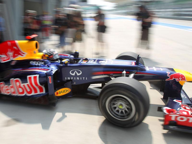 Red Bull Formula One driver Sebastian Vettel of Germany drives out of his pit lane garage during the first practice session at the Malaysian Formula One Grand Prix at Sepang, Malaysia. (AP Photo/Dita Alangkara)