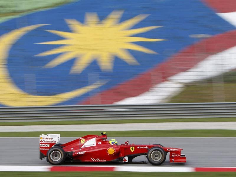Ferrari Formula One driver Felipe Massa of Brazil steers his car during the first practice session at the Malaysian Formula One Grand Prix at Sepang, Malaysia. (AP Photo/Lai Seng Sin)