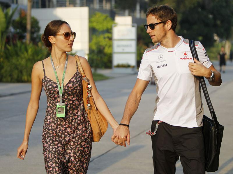 McLaren Formula One driver Jenson Button of Britain walks with his girlfriend Jessican Michibata as he arrives at the circuit for the first practice session at the Malaysian Formula One Grand Prix at Sepang, Malaysia. (AP Photo/Lai Seng Sin)
