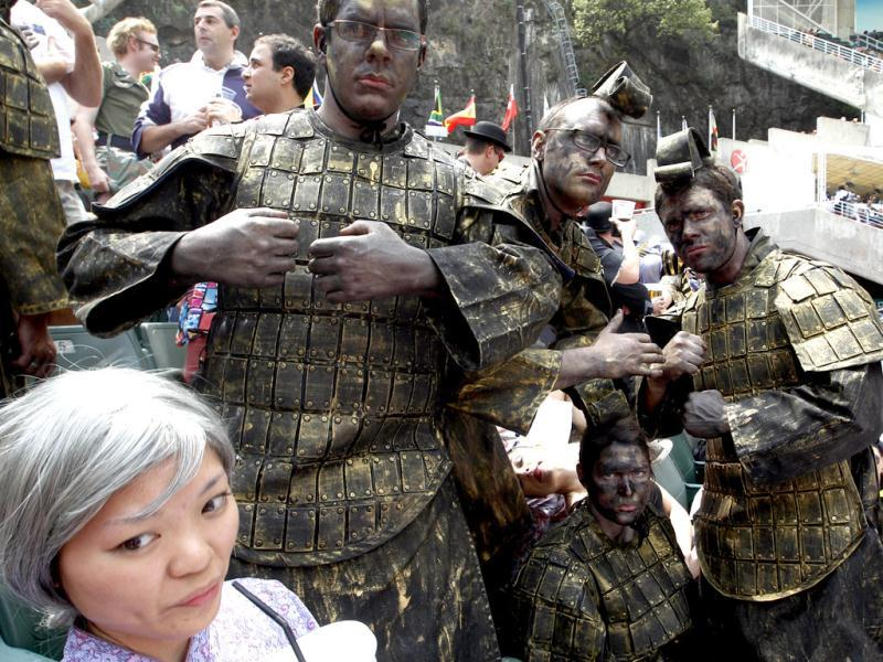 Rugby Fans dressed as old Chinese armored warriors show at a stand during the Hong Kong Sevens rugby tournament in Hong Kong.