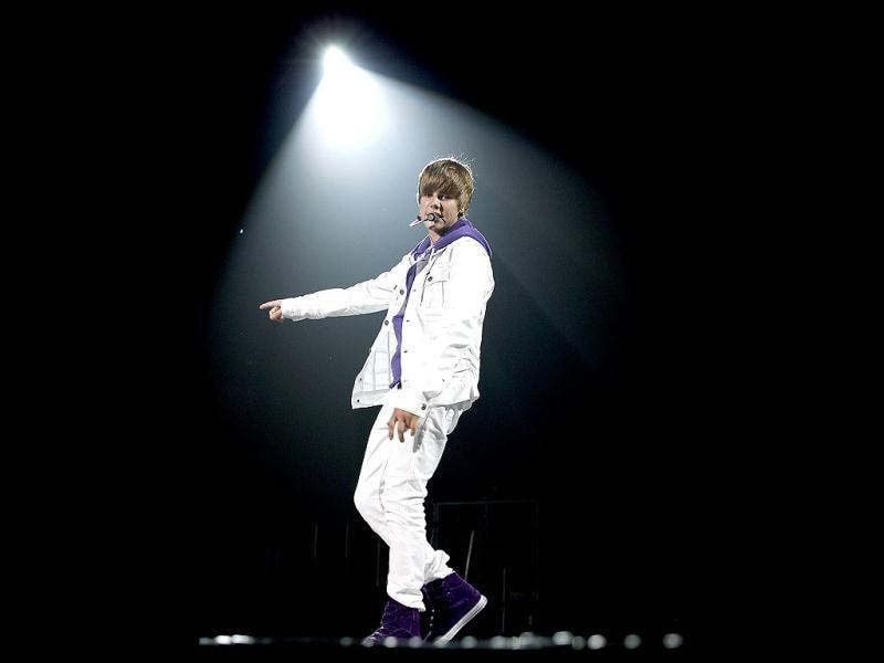 Justin Bieber's debut single, One Time, was released in 2009 and charted in the top thirty in several international markets.