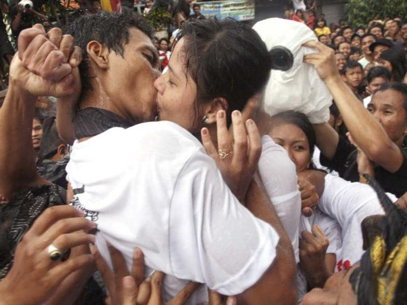 Balinese youths take part in the traditional kissing festival called 'Omed-Omedan' in the village of Sesetan in Denpasar, where participants engage in prayer and dancing while being doused with water, eventually culminating in hugs and kisses among couples as well as strangers. Reuters/Zul Edoardo