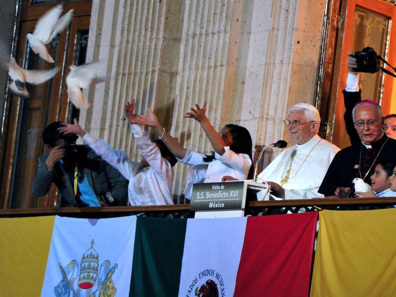 Pope Benedict XVI looks at white doves freed by children on the balcony of the Casa del Conde Rul in Guanajuato, Mexico. Benedict arrived in Mexico Friday afternoon, a decade after the late Pope John Paul II's last visit. Benedict's weeklong trip to Mexico and Cuba is his first to both countries. (AP Photo/Gregorio Borgia)