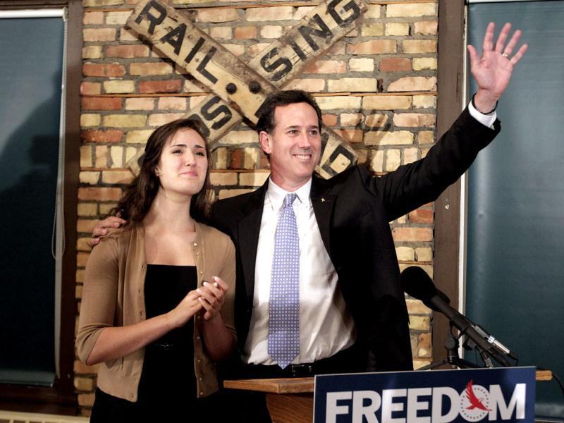 Republican presidential candidate, former Pennsylvania Sen. Rick Santorum, right, is joined by his daughter Sarah Maria during a news conference in Green Bay, Wis. Santorum won the Louisiana Republican presidential primary Saturday, beating front-runner Mitt Romney in the race to challenge President Barack Obama. AP Photo/Jae C. Hong