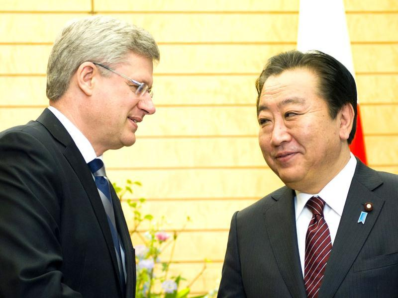 Prime Minister Stephen Harper, right, meets with Japanese Prime Minister Yoshihiko Noda at his office in Tokyo, Japan. AP Photo/The Canadian Press, Sean Kilpatrick
