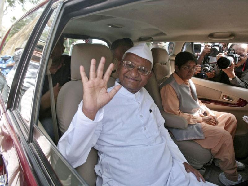 Veteran Indian social activist Anna Hazare waves to his supporters after his visit at the Mahatma Gandhi memorial at Rajghat, ahead of his day-long hunger strike against corruption in New Delhi. Multi-billion dollar corruption scandals in India have fed middle-class frustration with the ruling classes, and a relentless campaign by Hazare last year forced the government to bow to his demands and agree to draft anti-corruption legislation. REUTERS/Parivartan Sharma