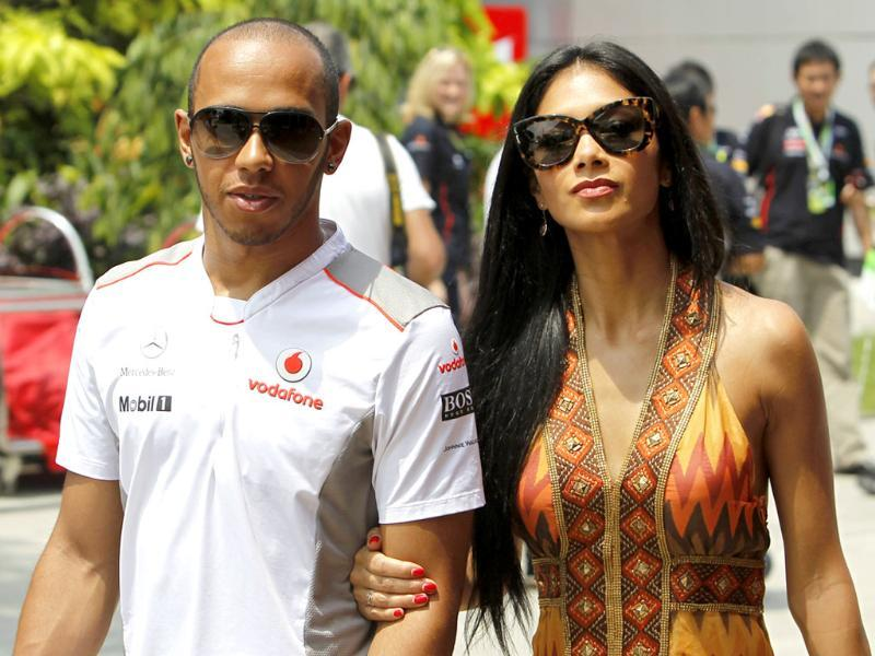 McLaren Formula One driver Lewis Hamilton of Britain arrives with his girlfriend singer Nicole Scherzinger for the Malaysian F1 Grand Prix at Sepang International Circuit outside Kuala Lumpur. Reuters/Edgar Su