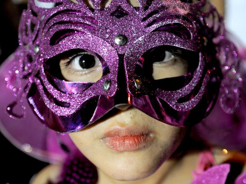 A masked reveller seen in the Joy for Life carnival in Managua. AFP Photo/Elmer Martinez