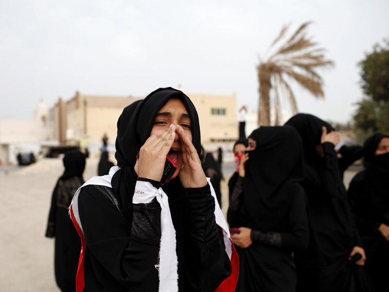 An anti-government protester shouts slogans during clashes in the district of Sitra in Bahrain. Reuters/Ahmed Jadallah