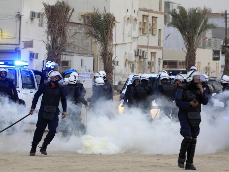 Riot policemen throw teargas at each other by accident during clashes with anti-government protesters in the district of Sitra. Reuters/Ahmed Jadallah