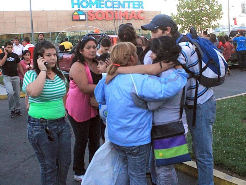 People gather outside a supermarket after an earthquake was felt in Talca, Chile. A magnitude-7.2 earthquake has struck just off the coast of central Chile, prompting an emergency evacuation order for people living near the ocean in case it spawns a tsunami. (AP Photo/Fabian Suazo)