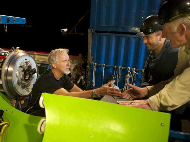 Filmmaker and National Geographic Explorer-in-Residence James Cameron gets a handshake from ocean explorer and U.S. Navy Capt. Don Walsh (R), just before the hatch on the Deepsea Challenger submersible is closed and the voyage to the deepest part of the ocean begins. (AP)