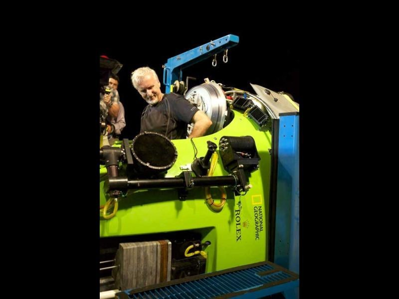 Filmmaker and National Geographic Explorer-in-Residence James Cameron slides into the hatch of the DeepSea Challenger submersible as he prepares for his record dive to the bottom of the Mariana Trench. (AP)