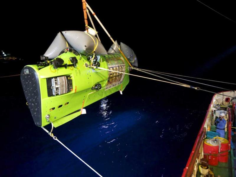 The Deepsea Challenger submersible carrying filmmaker and National Geographic Explorer-in-Residence James Cameron is hoisted into the Pacific Ocean on its way to the Challenger Deep, the deepest part of the Mariana Trench. (AP)