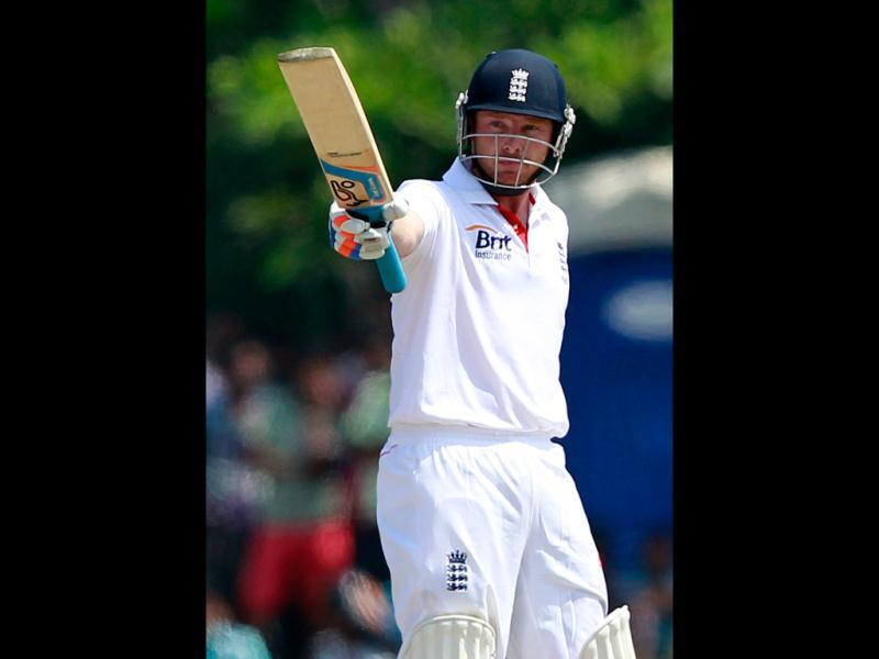 England's Ian Bell raises his bat after scoring a fifty runs during the second day of first test cricket match against Sri Lanka in Galle. REUTERS/Dinuka Liyanawatte