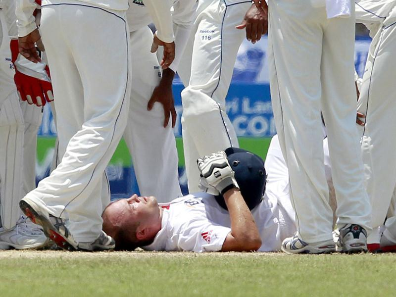 England's Jonathan Trott lies on the ground after he collided with Sri Lanka's Prasanna Jayawardene during the second day of the first test cricket match against England in Galle. REUTERS/Dinuka Liyanawatte