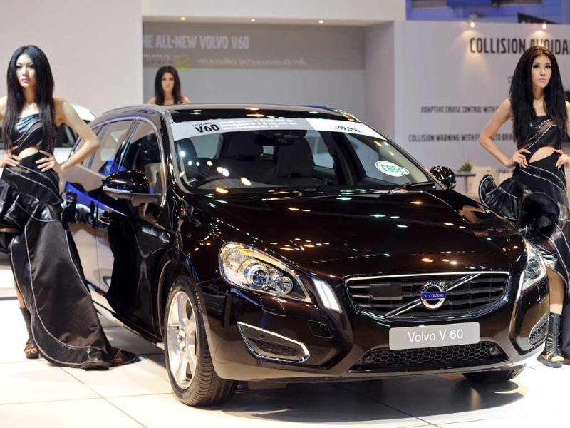 Thai models pose next to the new Volvo V60 on displayed at the 33rd Bangkok International Motorshow. AFP Photo/Pornchai Kittiwongsakul