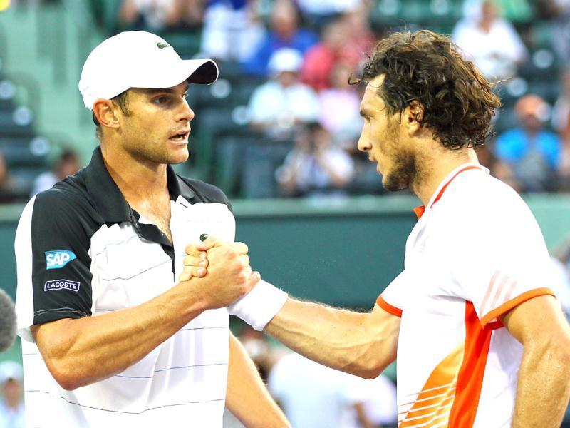 Juan Monaco of Argentina meets Andy Roddick of the USA at the net after defeating him during Day 9 at Crandon Park Tennis Center at the Sony Ericsson Open in Key Biscayne, Florida. Al Bello/Getty Images/AFP