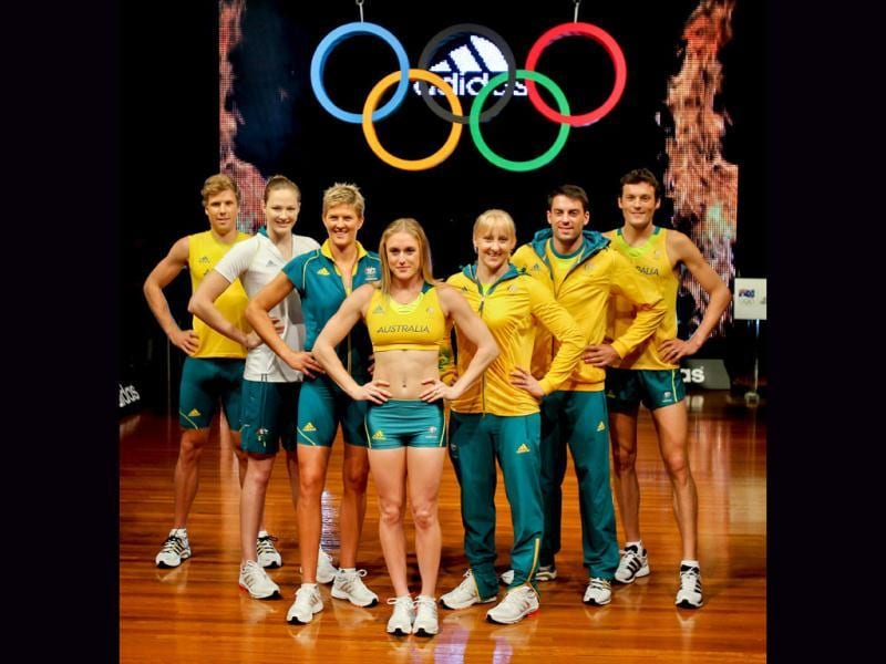Australian Olympic athletes (L to R) Henry Frayne, Cate Campbel, Natalie Cook, Sally Pearson, Jessica Schipper, Mitchell Watt and Craig Mottram pose during the unveiling of the Australian Olympic team uniforms at Sydney Olympic Park. The London Olympics take place from July 27 to August 12. AFP Photo/Mark Gunter