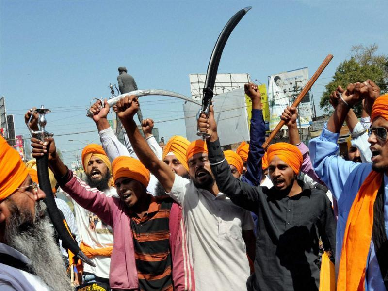Members of a Sikh organisation shout slogans at a protest during Punjab bandh called over the death sentence to Balwant Singh Rajoana in the Beant Singh assassination case, in Amritsar. PTI Photo by Deepak Sharma