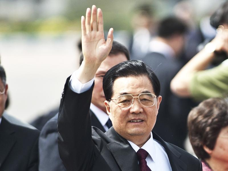 Chinese President Hu Jintao waves upon arrival at Indian Air Force station in New Delhi. AFP Photo/Prakash Singh