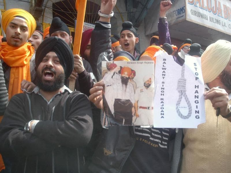 Sikhs raise slogans against the Prime Minister and the UPA chairperson during a protest in Srinagar demanding amnesty to Balwant Singh Rajoana, assassin of former Punjab chief minsiter Beant Singh who is scheduled to be hanged on March 31.