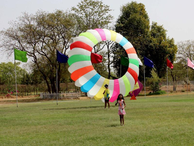 A frisbee shaped kite at The one day International Kite Festival on the occasion of Rajasthan Day at Polo Ground in Jaipur on Wednesday. Agencies