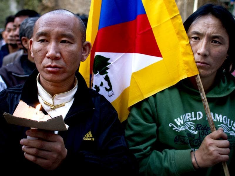 Exile Tibetans participate in a candle light vigil in solidarity with 27-year-old Tibetan Jamphel Yeshi, who immolated himself in New Delhi, in Dharmsala on March 28, 2012. AP Photo/ Ashwini Bhatia