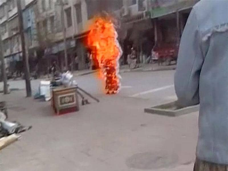 Tibetan Buddhist nun Palden Choetso burns on the street in Daofu, or Tawu in Tibetan, in this still image taken from video shot on November 3, 2011 and released to Reuters on November 22. Reuters/Students For A Free Tibet via Reuters TV