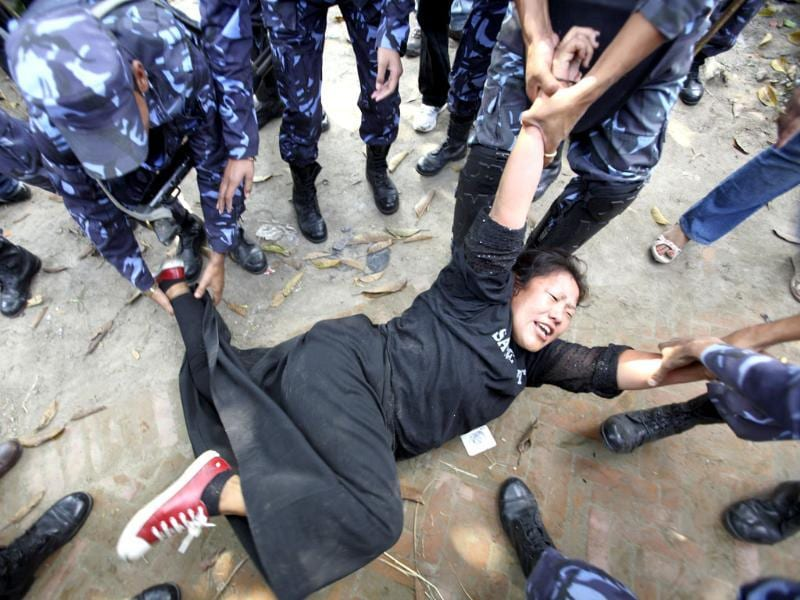Nepalese police arrest a Tibetan woman during a protest in Kathmandu on November 1, 2011. With China's influence over Nepal increasing, the Nepalese government stands strong against Tibetans exiles whose protests in support of their homeland has increased in recent years. Reuters/Navesh Chitrakar