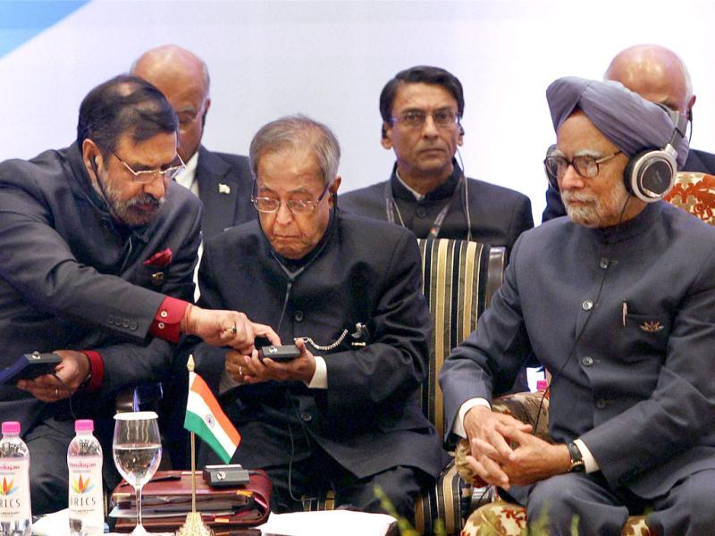 Prime Minister Manmohan Singh with finance minister Pranab Mukherjee, commerce and industry minister Anand Sharma and officials at a session of the 4th BRICS Summit in New Delhi. PTI/Shahbaz Khan