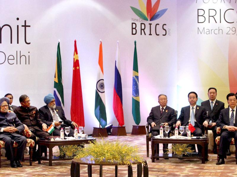 Prime Minister Manmohan Singh and Chinese President Hu Jintao attending a session of the 4th BRICS Summit in New Delhi. PTI/Shahbaz Khan