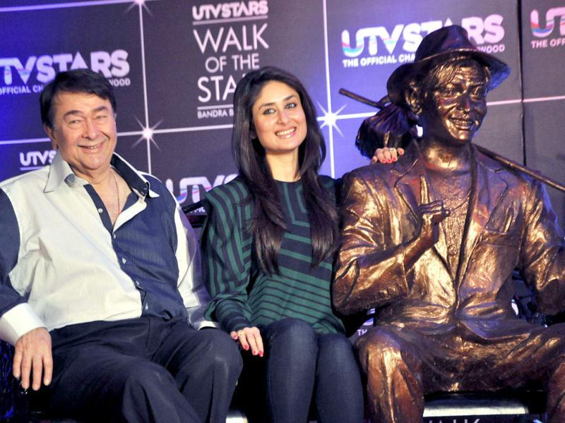 Kareena Kapoor and her father Randhir Kapoor attend the UTV's Walk of the Stars promenade launch. (AFP PHOTO)