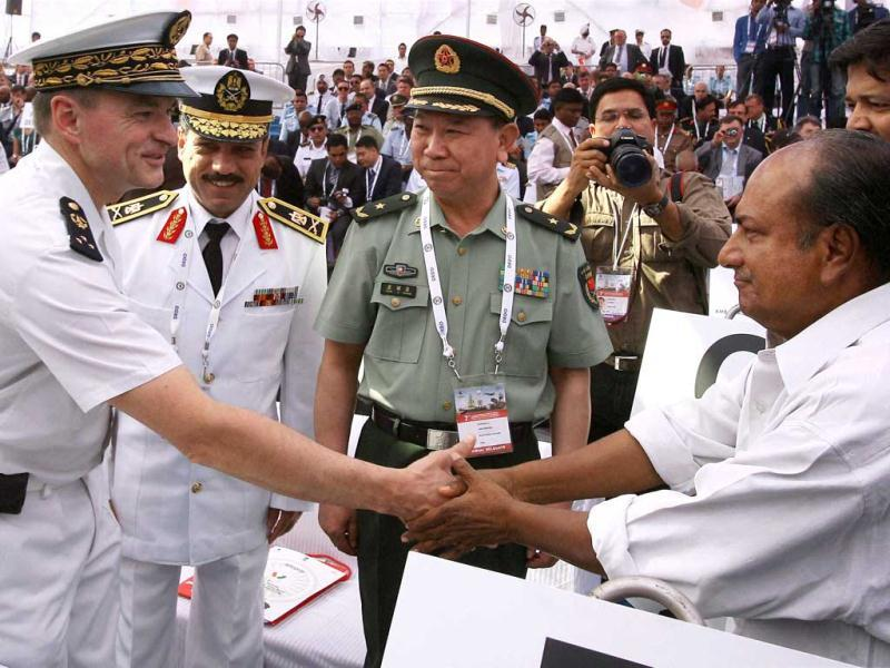 Defence minister A K Antony talks with foreign defense dignitaries at the Defexpo 2012 at Pragati Maidan in New Delhi on Thursday. PTI Photo/Kamal Kishore.