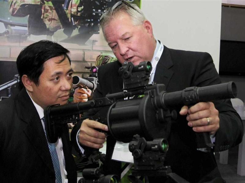 Foreign delegates check features of a weapon system at the Defexpo 2012 at Pragati Maidan in New Delhi on Thursday. PTI Photo/Kamal Kishore.