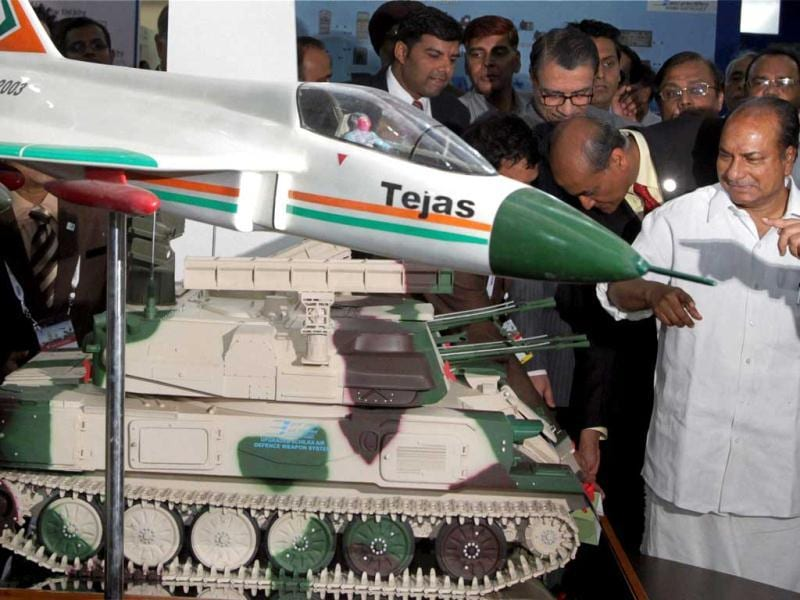 Defence minister A K Antony admires defence equipment after inaugurating Defexpo 2012 at Pragati Maidan in New Delhi on Thursday. PTI Photo/Kamal Kishore.