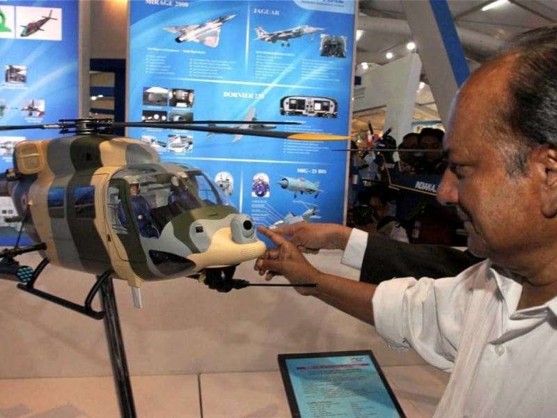 Defence minister AK Antony admires a model of defence equipment after inaugurating Defexpo 2012 at Pragati Maidan in New Delhi on Thursday. PTI Photo/Kamal Kishore.