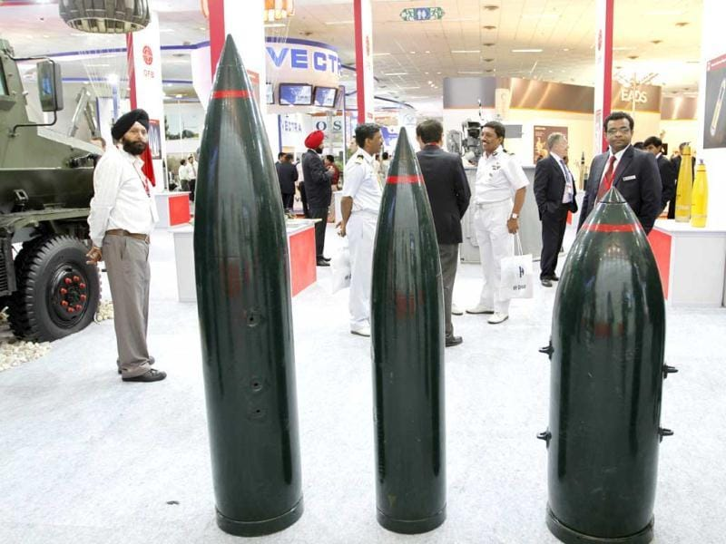 Visitors look at the defense equipment on display at the Defexpo 2012 at Pragati Maidan in New Delhi on Thursday. HT Photo/Arvind Yadav.
