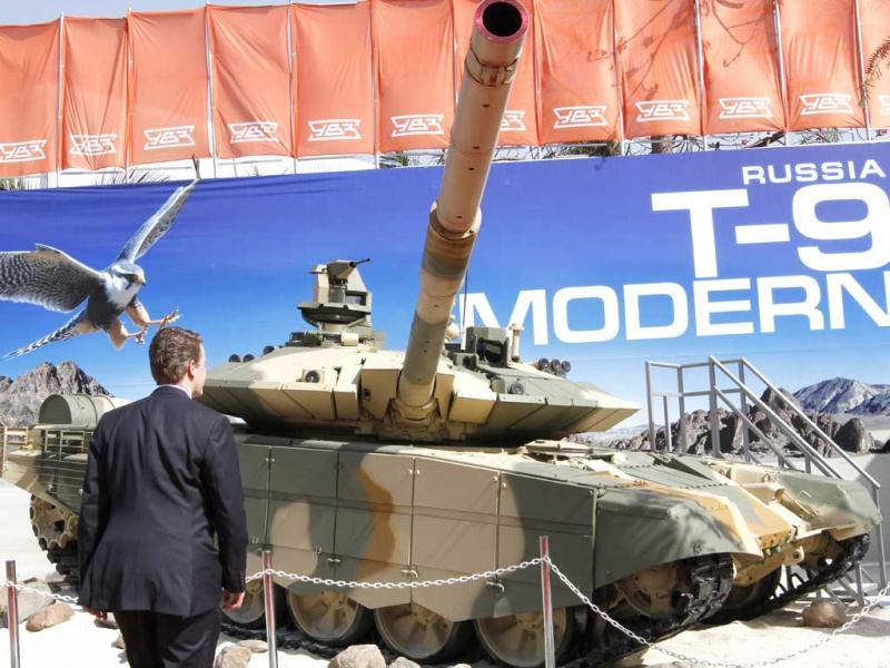 Visitors look at the Russian defence equipment - T-90S Tank on display at the Defexpo 2012 at Pragati Maidan in New Delhi on Thursday. HT Photo/Arvind Yadav.