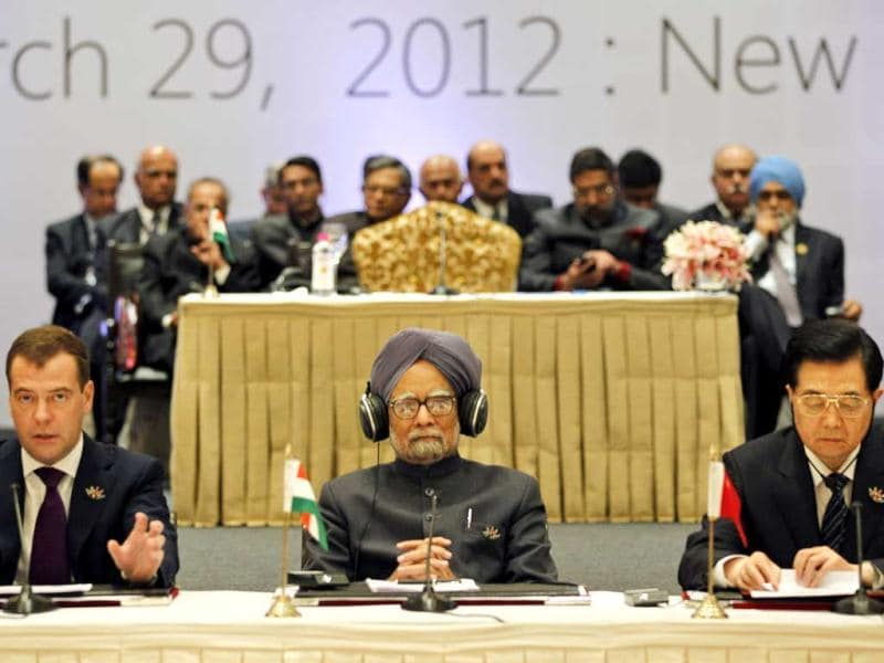 Leaders of states, from left to right, Russian President Dmitry Medvedev, Prime Minister Manmohan Singh and Chinese President Hu Jintao attend the plenary session of BRICS 2012 Summit in New Delhi. (AP Photo/Saurabh Das)