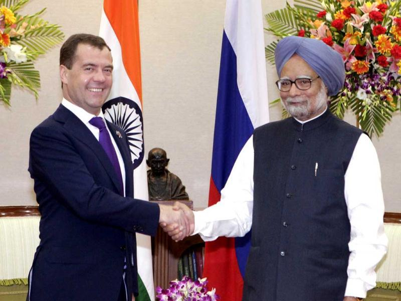 Russian President Dmitry Medvedev, left, and Prime Minister Manmohan Singh shake hands during their meeting on the sidelines of the BRICS summit in New Delhi. (AP Photo/RIA Novosti Kremlin, Yekaterina Shtukina, Presidential Press Service)