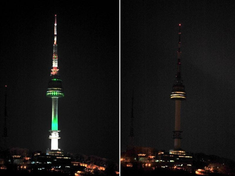 This combo of pictures shows Seoul's landmark the Seoul Tower before (L) and after (R) its lights were turned off for the 6th annual Earth Hour global warming campaign at Seoul.  Millions of people were expected to switch off their lights for Earth Hour in a global effort to raise awareness about climate change that was even to be monitored from space.  AFP Photo / Kim Jae-Hwan